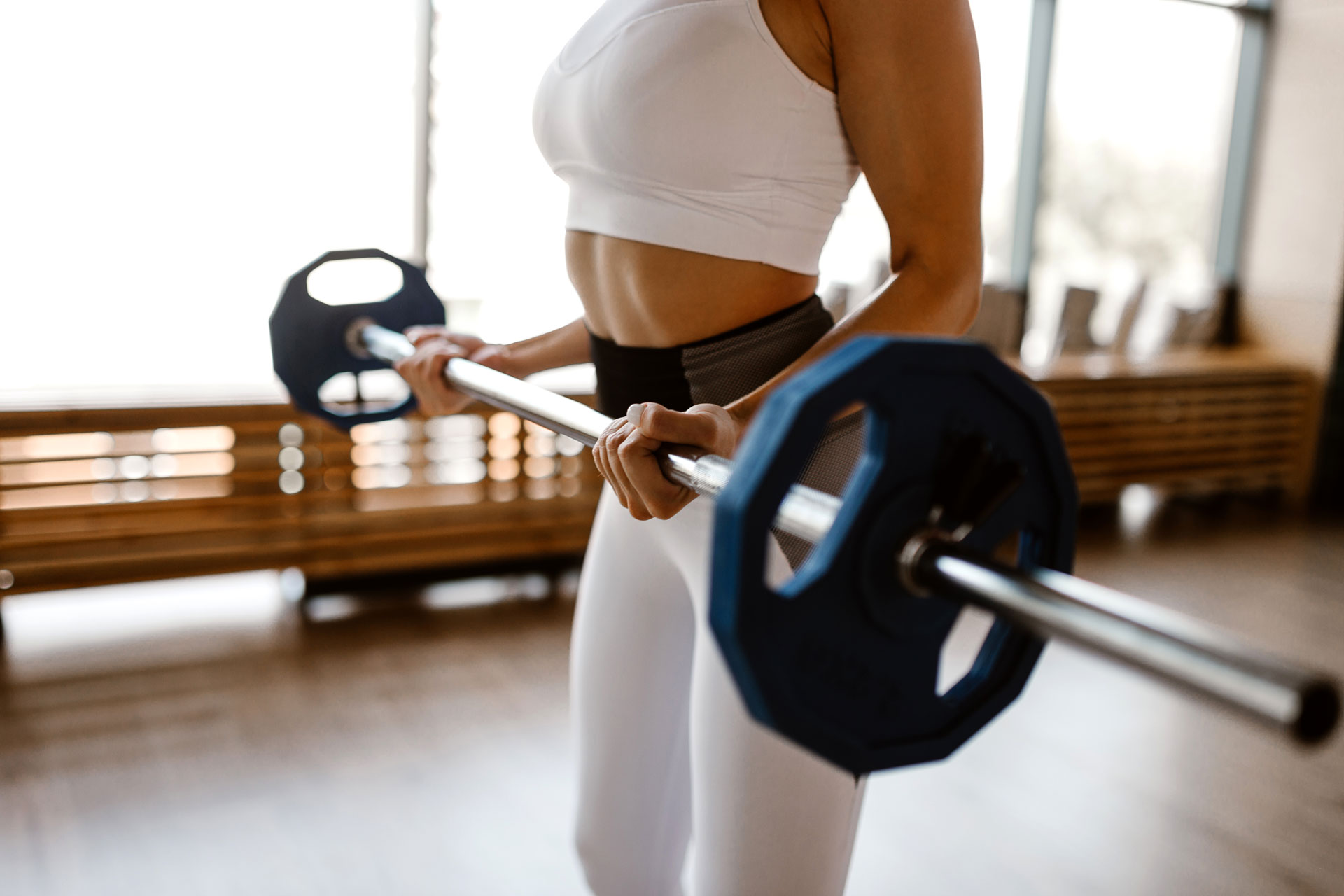 athletic-girl-dressed-in-white-sports-top-and-tigh-UB2DFXZ.jpg