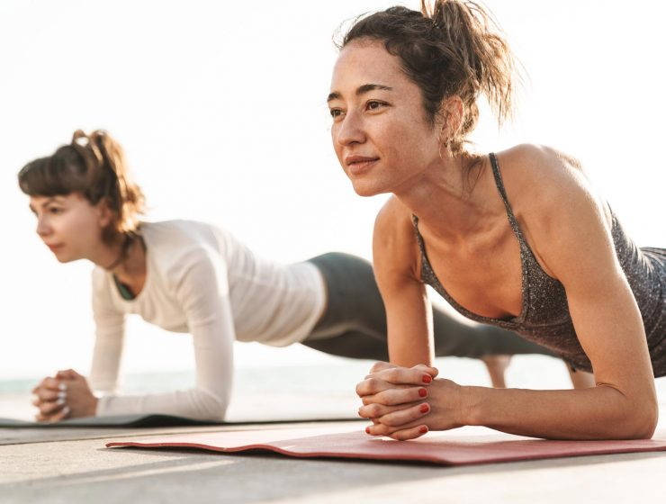 photo-of-focused-young-women-doing-exercises-on-ma-XKYPDWG.jpg